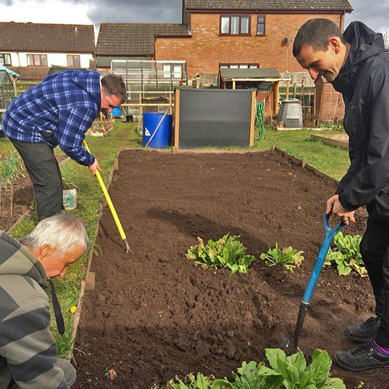 Green Days Day Care Adults with Learning Disabilities taking part in community gardening