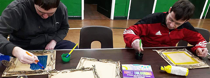 Two men doing arts and crafts at Green Days Day Care and learning transferable skills