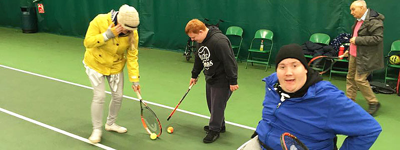 Group playing tennis with Green Days Day Care