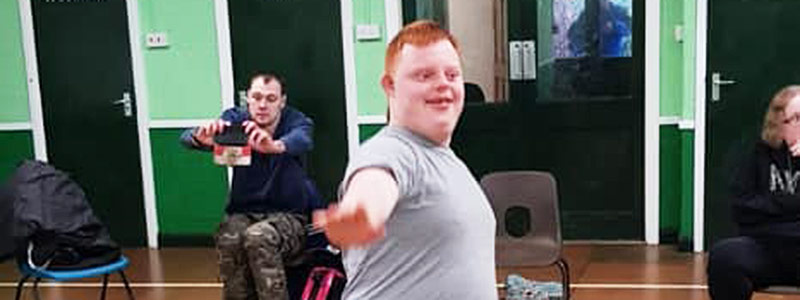 Adult with learning disabilities dancing at Green Days Day Care