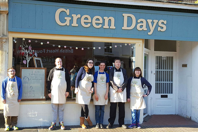 Green Days Day Care shop with employees standing outside